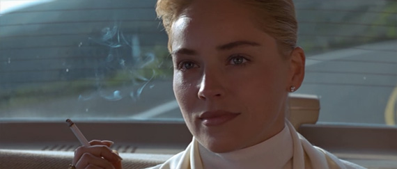 Sharon Stone smirking in the squad car Basic Instinct 1992 movieloversreview.blogspot.com