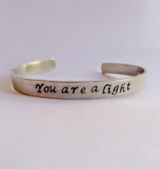 http://www.seebeautiful.com/team-tripp-you-are-a-light-cuff.html