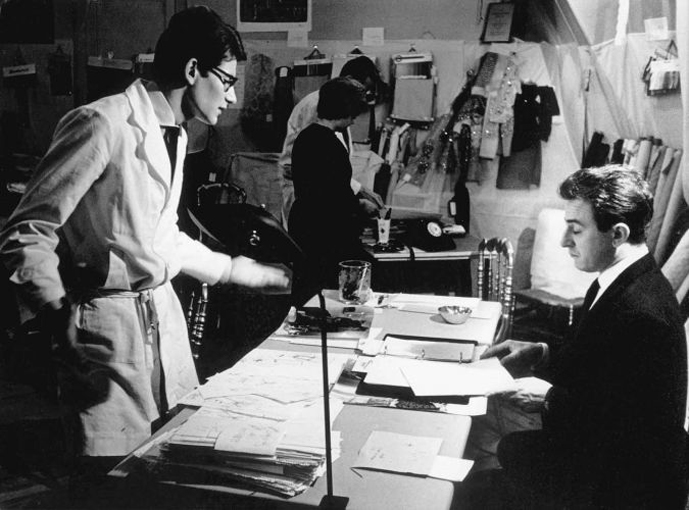 via fashioned by love | Yves Saint Laurent and Pierre Berge at rue Jean-Goujon December 1961 discussing YSL photographed by Pierre Boulat
