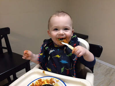 Baby Eating Squash and Meatballs