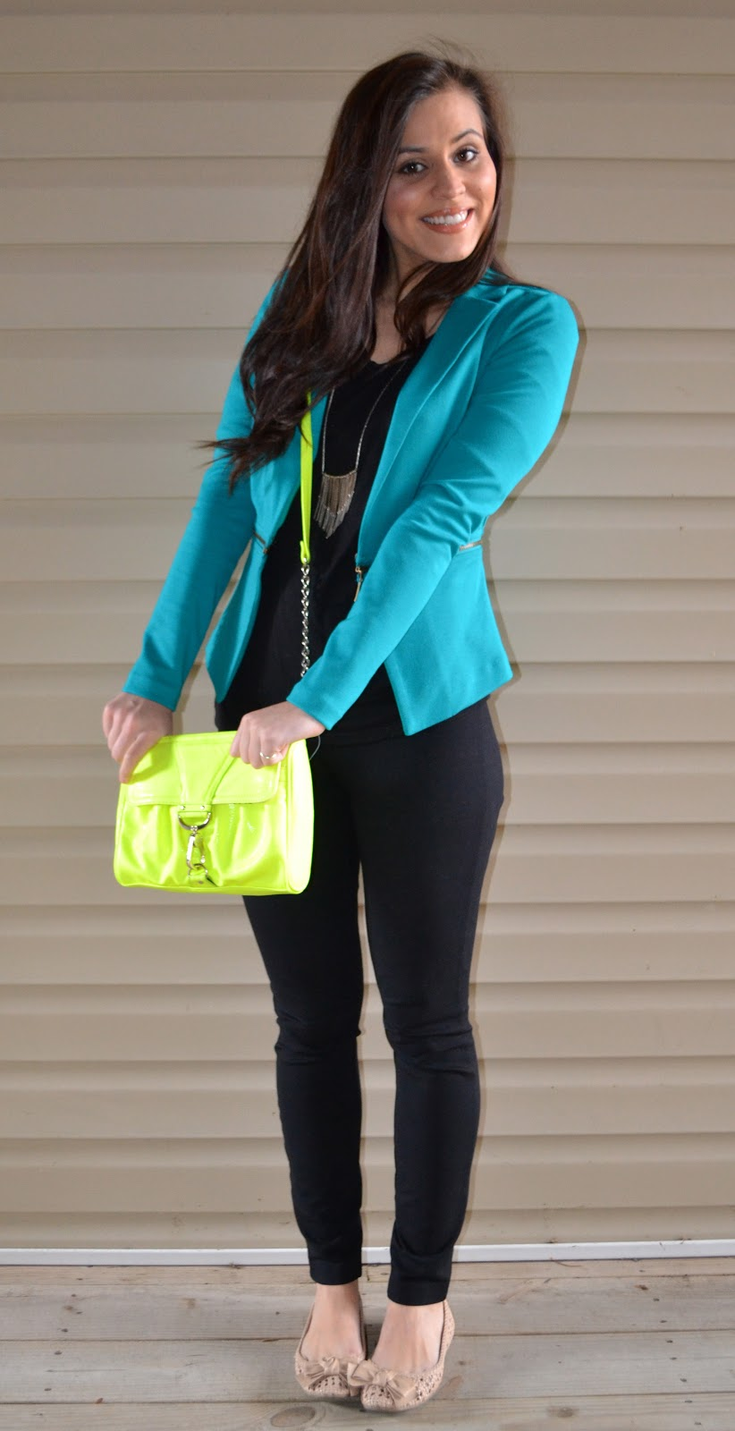 TealConrad Teal Blazer -- $29.99, Target. | Black top -- $12.99, H&M. | Pixie Pants -- $80.00, J.Crew. | Bow flats -- $10.00, LC Lauren Conrad via Khols sale.