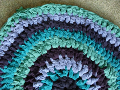 Handmade crochet rag rug, recycling and reusing old textiles and t-shirts