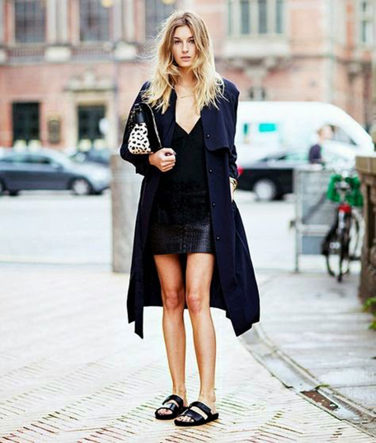 Camille Charrière from Camille Over the Rainbow, street style, all black, leather mini skirt, black slides sandals, messy blond hair