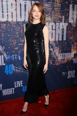 Emma Stone in Christian Dior dress at 2015 SNL 40th Anniversary Celebration red carpet