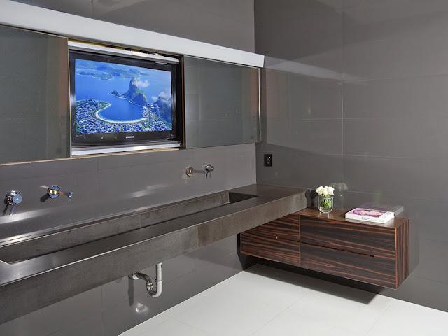 Photo of large tv on the wall of modern bathroom