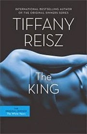Cover art for The King, featuring a pale-skinned woman's naked back tinged in blue. She lays on her left side.