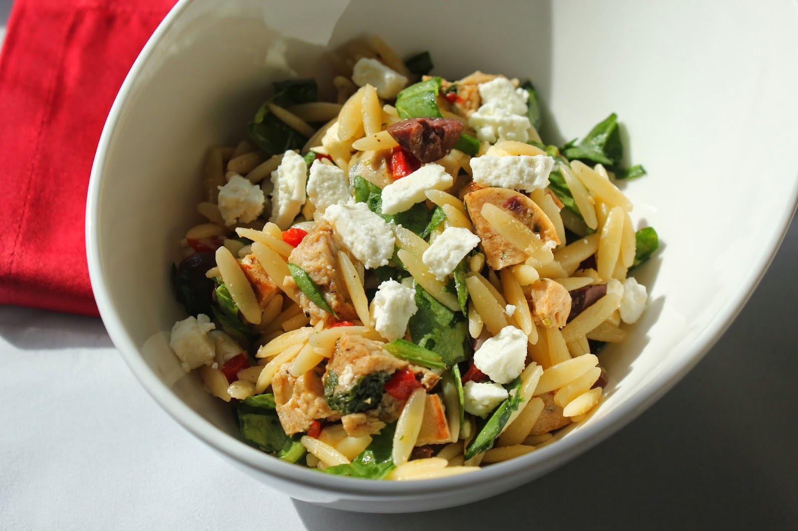 Orzo salad with chicken sausage, spinach, and feta