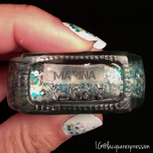 Reverse gradient using Marina glitter nail polish by Paint Nail Studio