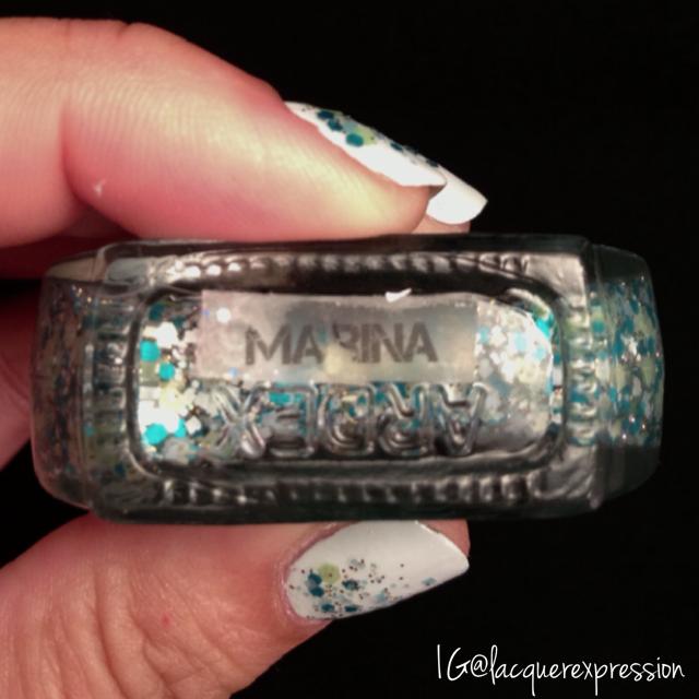 Reverse gradient using Marina glitter nail polish by Paint Nail Studio