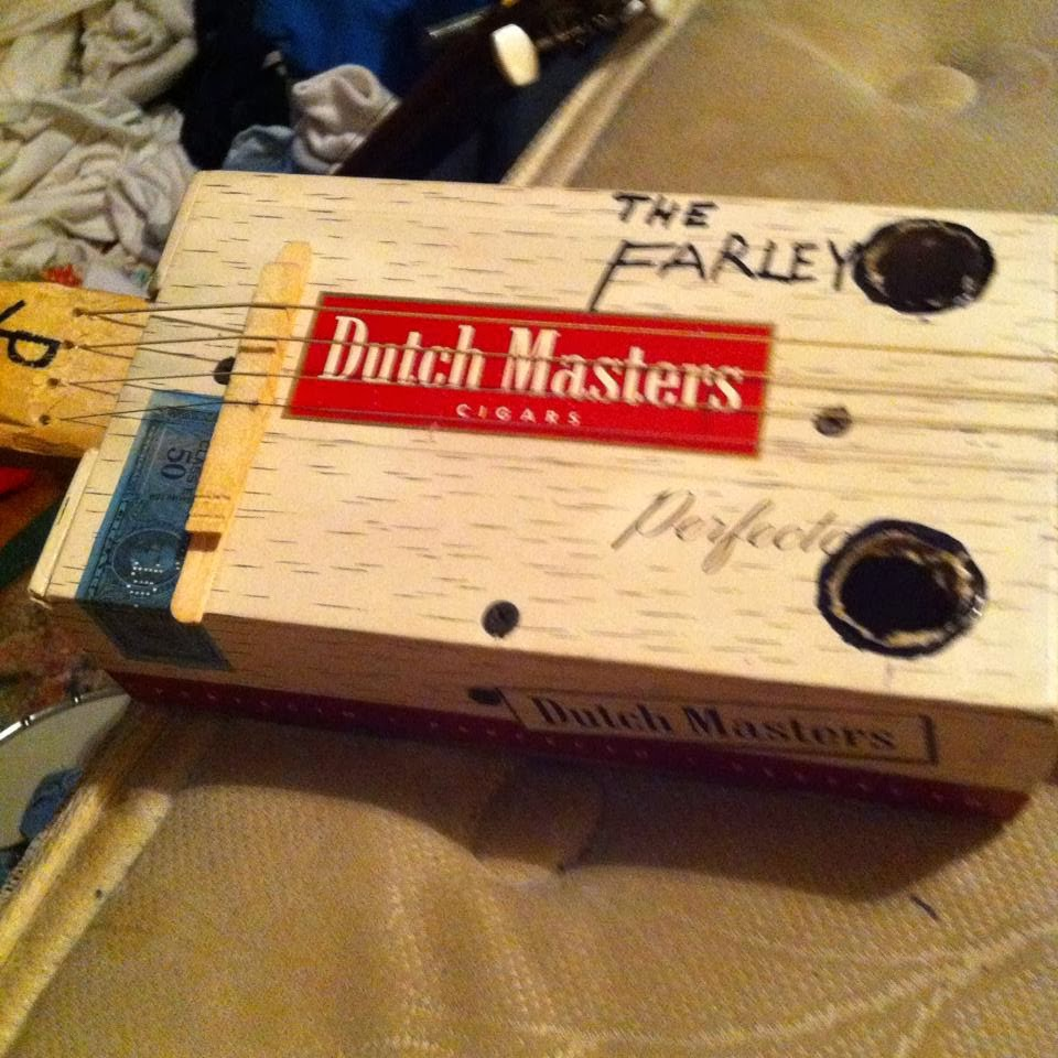 A four string cigar box guitar
