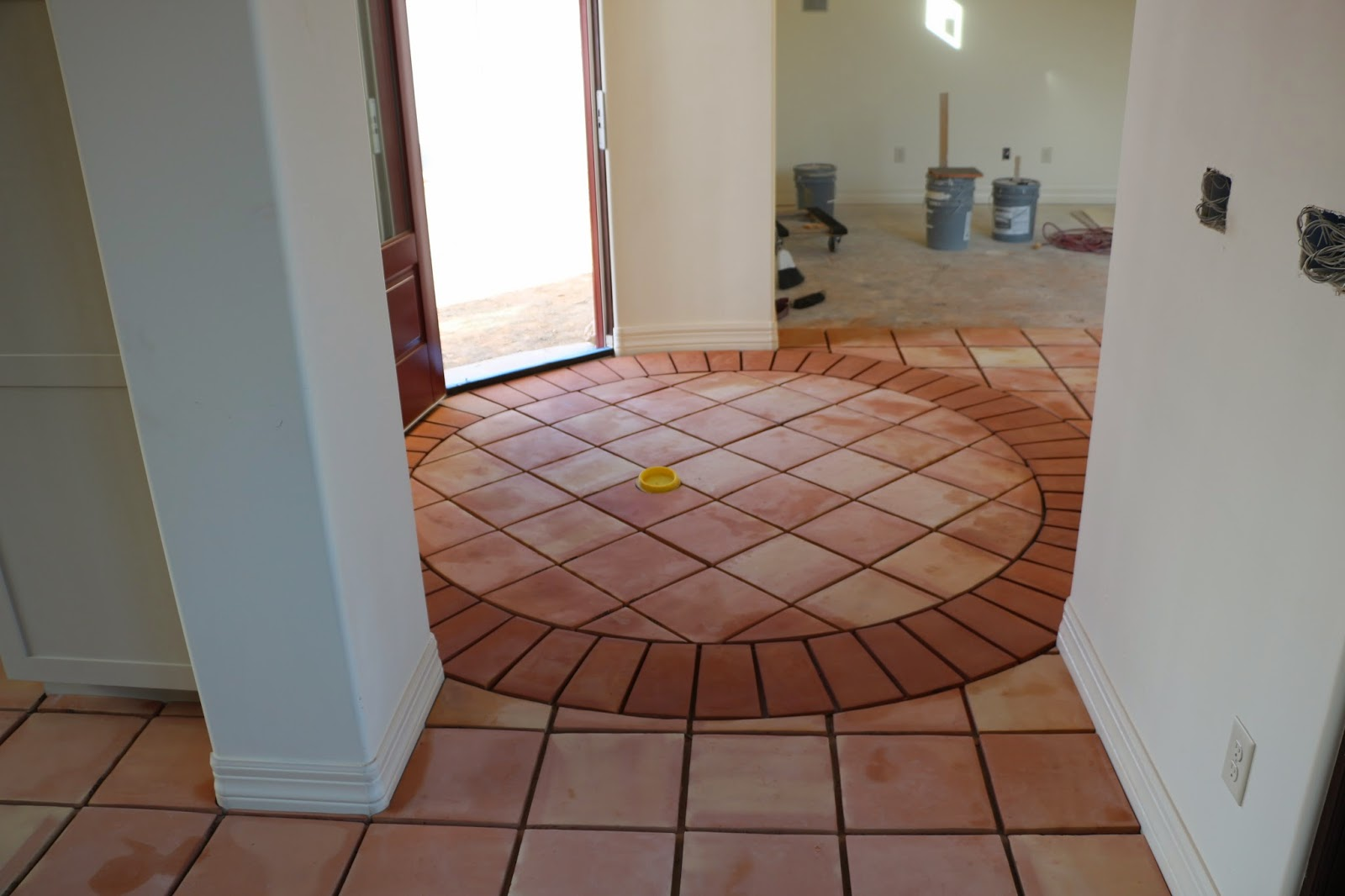 saltillo tiles in circle room, terra cotta tiles in a circle