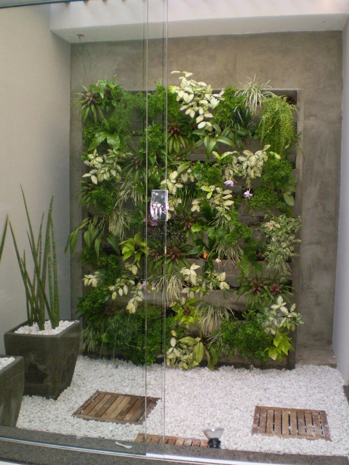 jardim vertical em muro:Pode ser usado para fazer somente um detalhe na decoração, como este