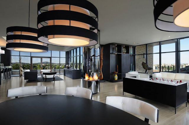 Picture of black and white modern penthouse interior as seen from the dining table
