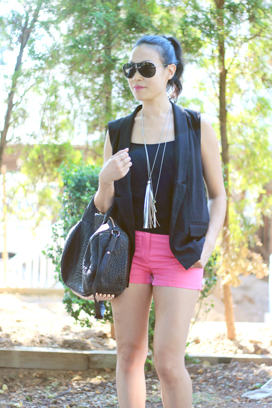 Urban Outfitters black tailored sleeveless blazer vest, H&M neon pink shorts, Fergalicious by Fergie Jasper gladiator sandals, Alexander Wang Rose Gold Rocco Bag, Versace shield sunglasses, fashion, style, summer