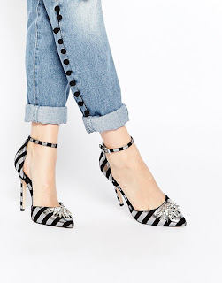 http://www.asos.com/ASOS/ASOS-NIGHT-PITCH-BLACK-Pointed-High-Heels/Prod/pgeproduct.aspx?iid=5540603&cid=4172&sh=0&pge=3&pgesize=36&sort=-1&clr=Silver%2fblack&totalstyles=2091&gridsize=3