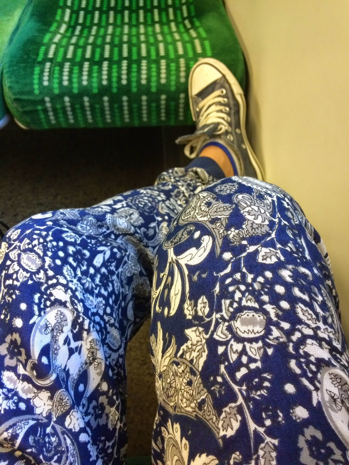 woman on train in mad trousers