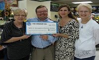 Kroger presents check to St.Bernadette Christian Action Food Pantry. Photo courtesy of St. Bernadette Catholic Church