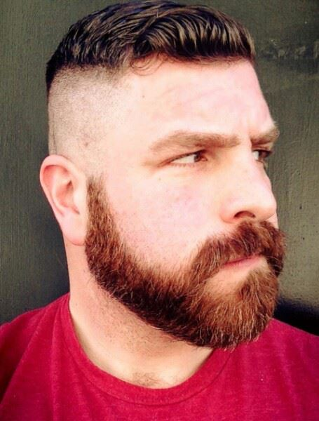 A man with an Undercut haircut and a beard.