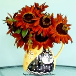 autumn beauty sunflowers in laurel burch cat vase