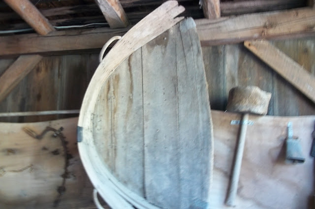 """Two handled """"shovel"""" for scooping grain.  A chore for children."""