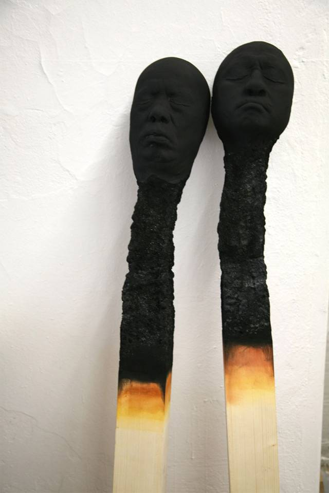German artist Wolfgang Stiller acquired several head molds and large pieces of wood. After experimenting with the various components the artist struck on an idea to create several large-scale burnt matches where the charred remains of each tip appeared as the face of a human, a series he calls Matchstickmen