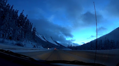 Dashcam shot of the snow and ice covered Highay Through Hell, the Coquihalla