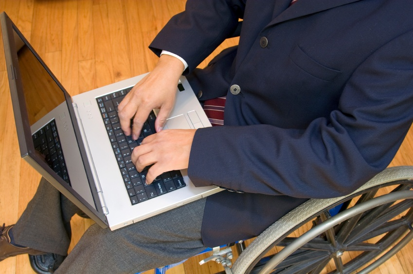 picture of wheelchair user with laptop