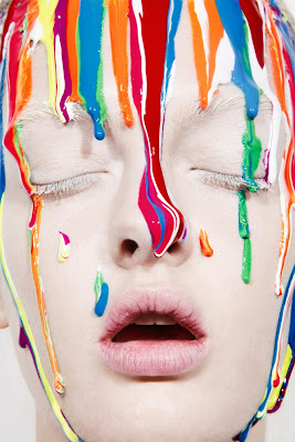 paint dripping down model's face, creative makeup
