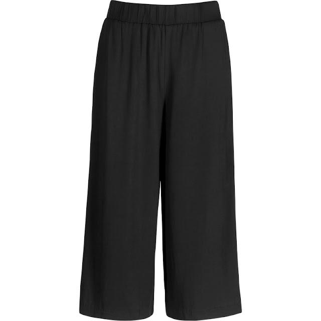 leveälahkeiset mustat housut
