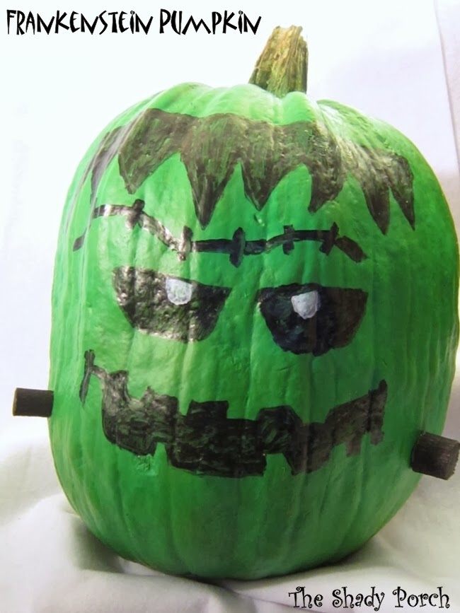 A green pumpkin with a Frankenstein face. #pumpkin #Fall #decoration