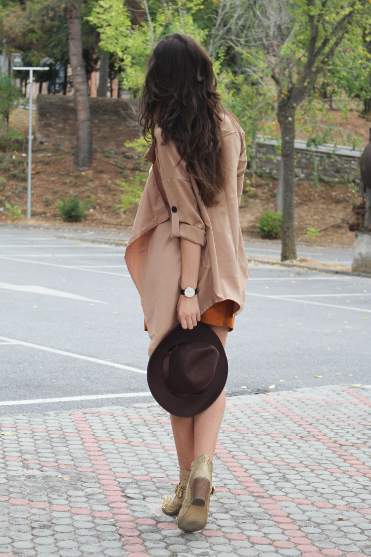 Suede skirt, camel trench, spiked boots, hat, silver necklace