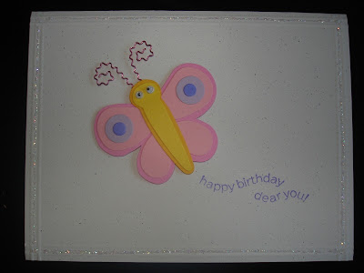 "White card with a glittery border and a dimensional butterfly sticker. Sentiment states ""happy birthday dear you."""