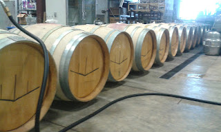 Oak barrels being filled with water to soak overnight