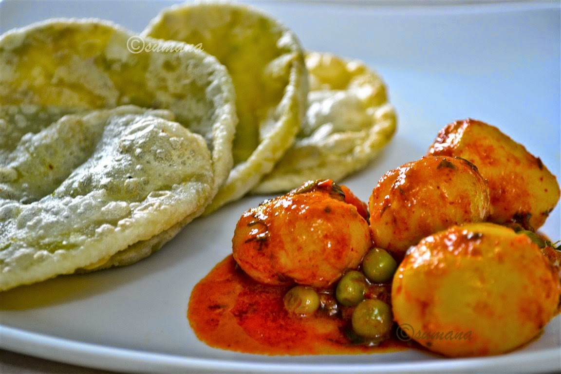 Koraishutir Kachuri is the poori or puri stuffed with spicy green peas