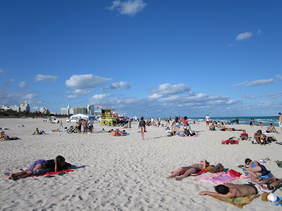 people laying out and tanning in South Beach Miami