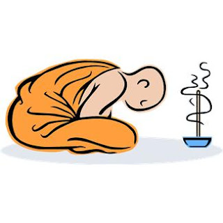picture of monk burning incense