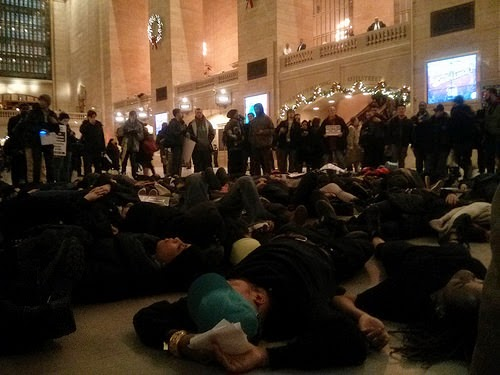 "Protesters Stage a ""Die In"" in Grand Central Station over the murders of Eric Garner and Michael Brown - December 9, 2014. (Photo by Peter)"