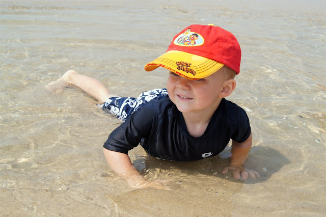 toddler playing at smith point beach