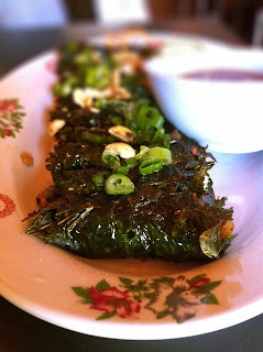 Beef in betel/vine leaves - superb image