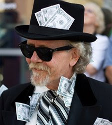 Man with cash stuffed in suit, hat