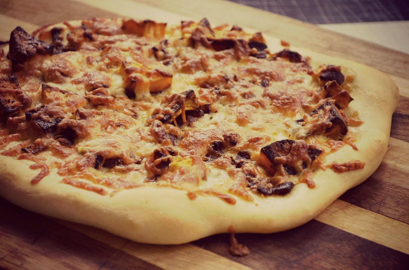 Pizza with Caramelized Onions and Crispy Bacon