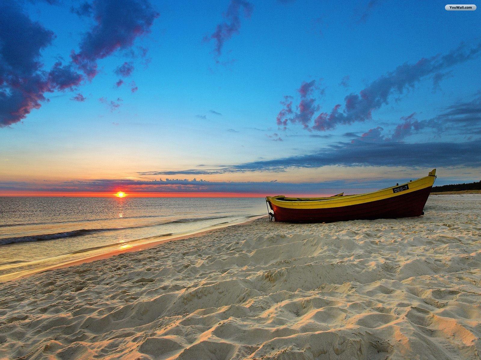 http://2.bp.blogspot.com/-1xb6vsdpndo/Tky7L0RbAeI/AAAAAAAAAEo/fUkB6OK0Nts/s1600/free+beach_sunset_wallpaper.jpg
