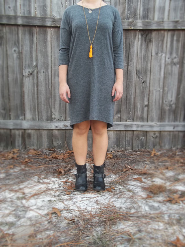 grey knit cocoon dress orange tassel necklace simple necklace filigree black ankle booties outfit dressember dress donate human trafficking