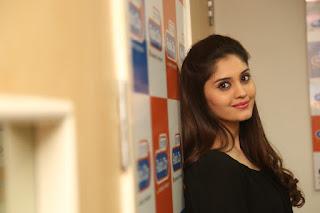 Surabhi Glamorous New Actress in Tight Black Top and Denim Leggings at Radio City FM