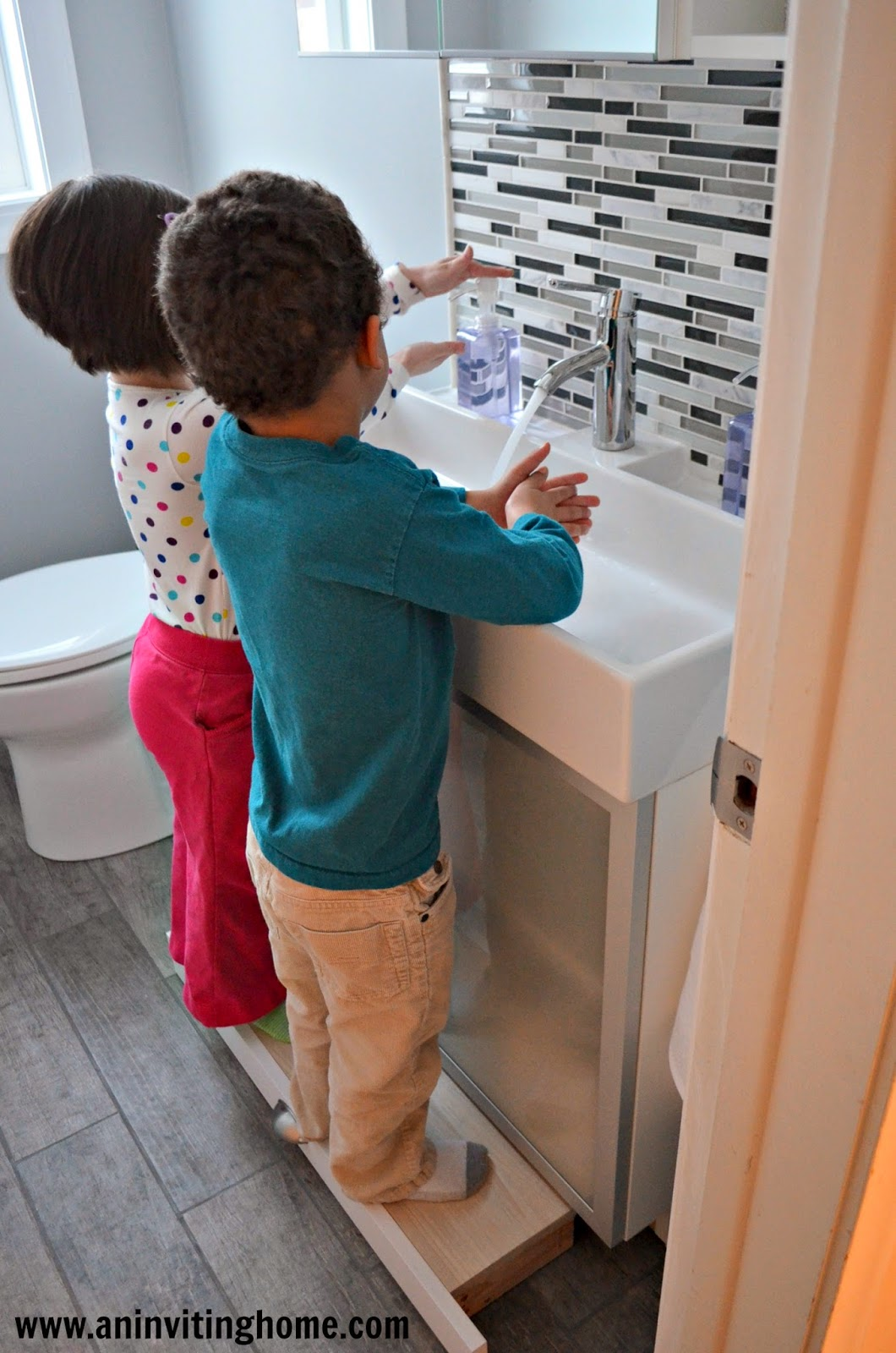 two kids washing hands at the same time