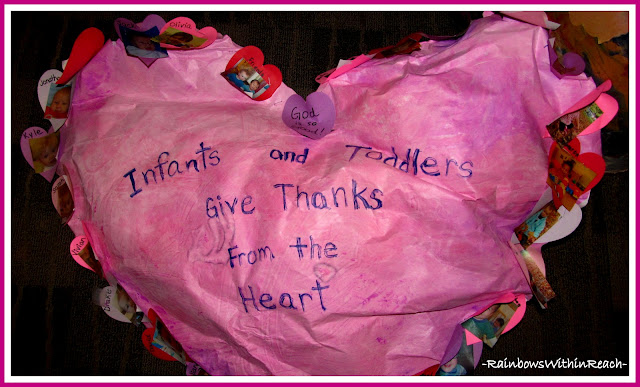 photo of: Infants and Toddlers Create Three Dimensional Over-sized Heart Painting