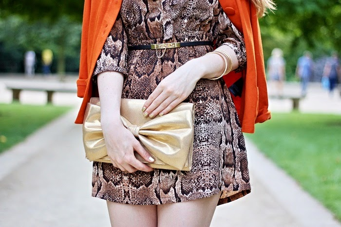 gold purse, orange blazer, snake print dress, retro style, blogger