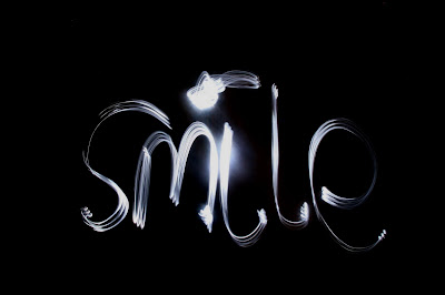 light drawing,torch, photo, photography, slow shutter speed, light writing, smile