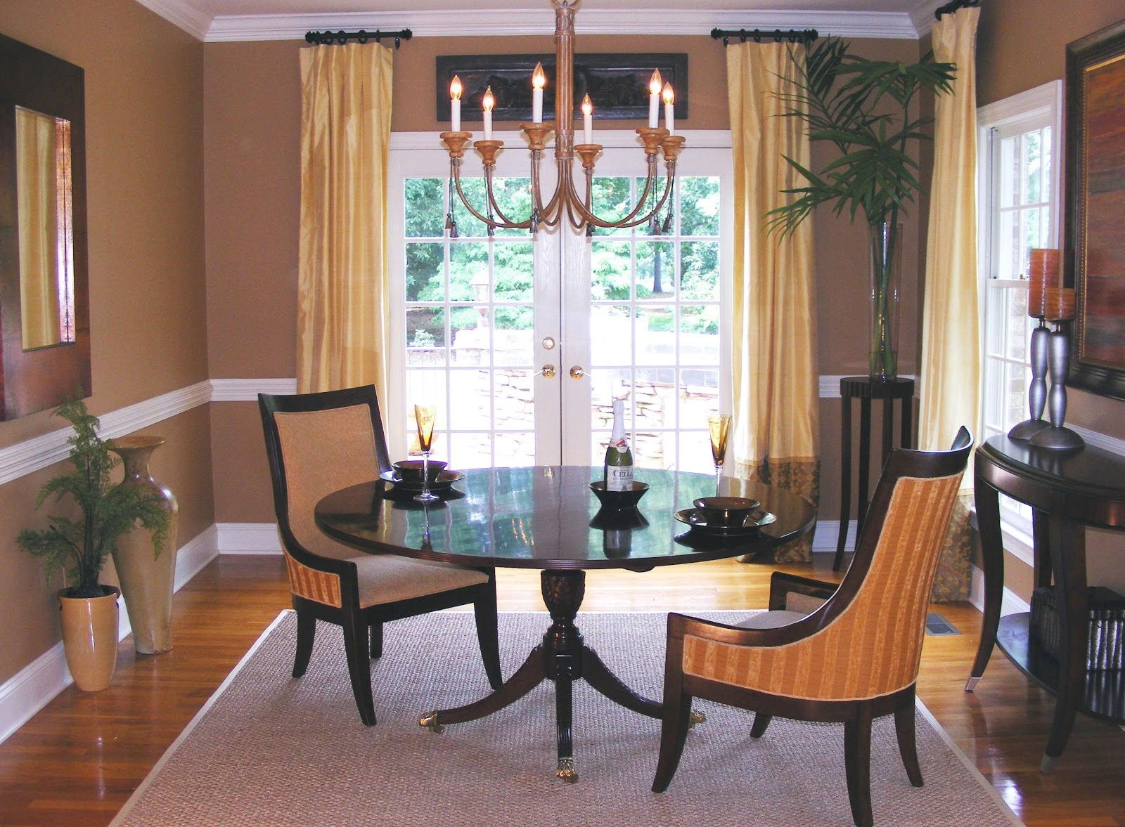 In this Greensboro NC dining room, the homeowner moves 4 chairs to the  living area when they're not needed for formal dining. This allows the  dining