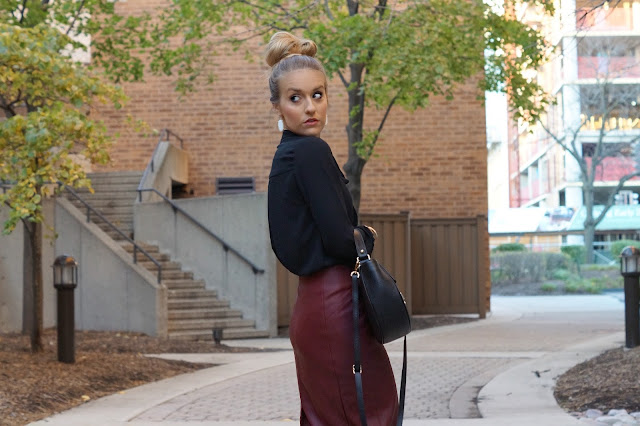 black blouse paired with leather skirt for work
